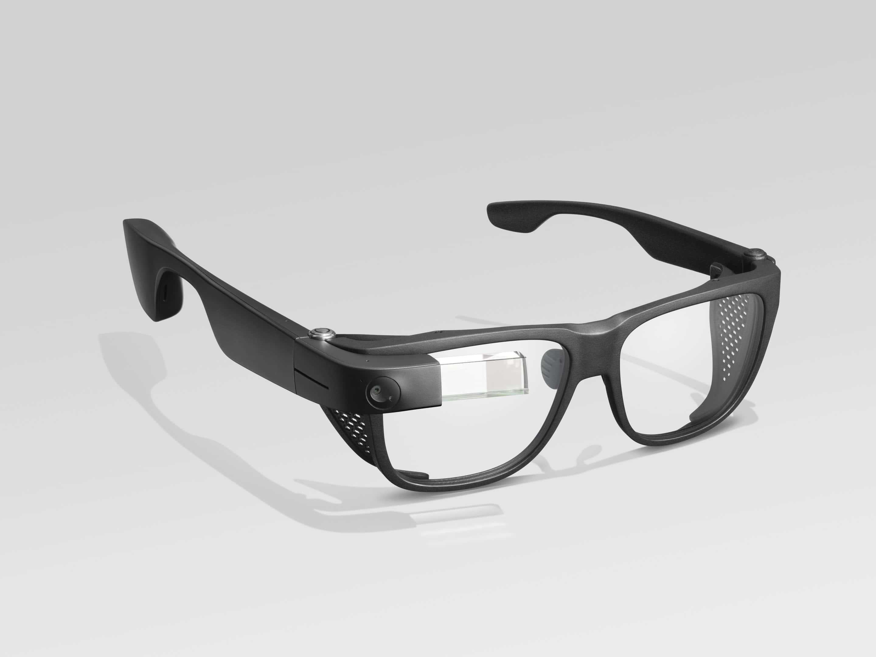 Photo of Envision Glasses with the Smith Optics frames; the frames are black plastic, 2 or 3 times thicker than the titanium frames